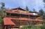 Two levels of wrap-around decks and views of mountains, forests, and mesas