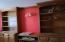 Coupled with vintage red walls and real wood this classy office roars!