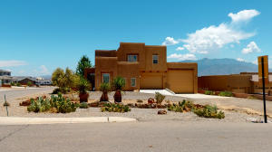 Front of home to show the RV Garage and two car garage with ample parking for guests.