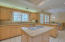 Spacious Kitchen with island Granite counters breakfast nook,pantry and access to