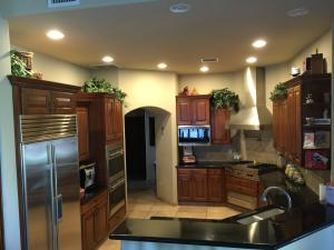Gourmet kitchen features Wolf and Sub Zero appliances. All stainless steel.