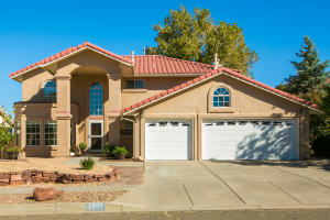BEAUTIFUL UPDATED FAR NE HEIGHTS HOME WITH A 3 CAR GARAGE