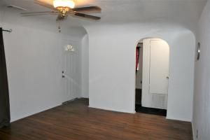 Living Room facing front door and hall to bedrooms