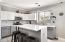 Beautifully detailed kitchen with granite, backsplash and custom island.