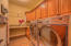 Spacious Laundry room with custom cabinets and work space