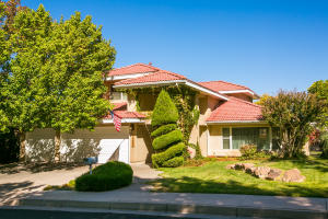 LOVELY TANOAN EAST HOME WITH A PITCHED, TILE ROOF & 3 CAR GARAGE