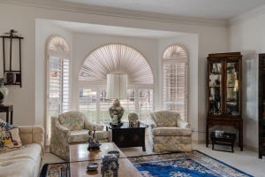 The more formal livingroom has Plantation shutters and mountain views