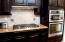 Kitchen gas cooktop/oven and microwave