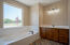 Owners suite bath with garden tub