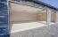 Stacked stone 3 car garage