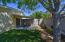 Backyard with shade tree and block wall for privacy