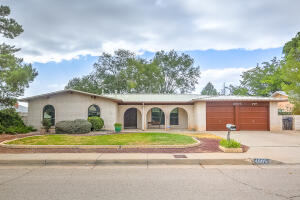 NORTHRIDGE CUSTOM ONE LEVEL RANCH ALL SIDES SLUMPROCK BRICK AND CUSTOM METAL ROOF ON LARGE LOT WITH MATURE TREES SHRUBS UPDATED PAINT CARPET MORE...