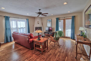 Lovely family room has 2 sets of French doors to the back yard, large east facing window, excellent lighting. It is open to the kitchen and creates a wonderful and gracious space to live in.
