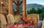 Dining area with majestic mountain views and walkout terrace