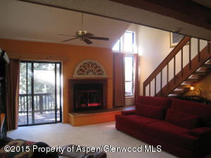 Open to kitchen and outdoor deck.
