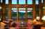 Main Lodge great room overlooks trout pond with mountain views beyond