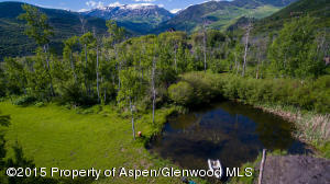 Wooded lot with pond and mountain views