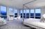 Wall of windows in the private upper level master suite takes in eastern and southern views