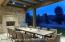 Inviting outdoor patio dining looks out on the private pond