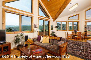 A light, bright comfortable mountain home with panoramic views up and down the valley.