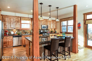 Kitchen has bar area for 3-4 stools in addition to the Dining Area!