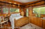 Connected to the river and trees, this private cabin is the 4th suite, with books and a wood stove to surround you.