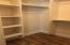 Basement bedroom walk-in closet
