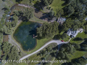 Aerial above pond & cabin