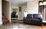 Living room looking towards den/front door