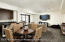 Entertainment room, with wet bar, wine refrigerator, walk-out patio area.
