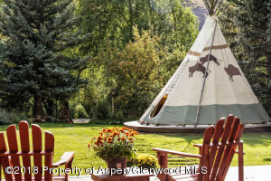 Tipi for ceremony or a hideaway for the kids. Gas fireplace inside!