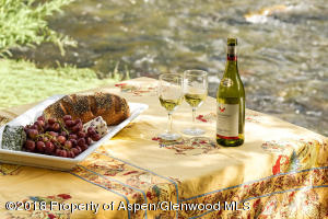 Cheese and wine is divine with the sound of the river to calm your senses.