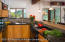 The kitchen features handsome granite countertops and is open to the living and dining areas.