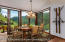 The dining room is literally surrounded by glass offering some of the best views in the home.