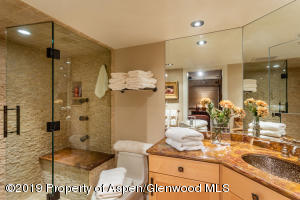 Top to bottom, stone, granite, ironwork and seamless shower door, with heated floors and abundant storage...