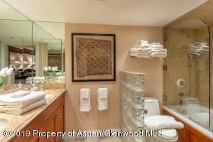 Spa-like, double vanity, heated floor, tub, glass wall detail and great storage.
