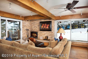 Corner location with three sets of sliding glass doors that create the perfect ski in/out accessibility.