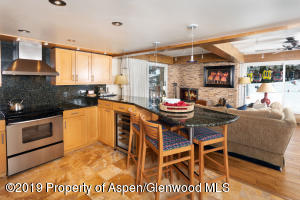 The kitchen enjoys 4 barstools for the casual dining and cooking activities.