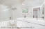 Master bathroom with soaking tub, shower, and radiant heated floors.