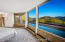Master bedroom and view of pool