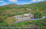 2.3 acres. Ability to build up to 15,000 sq ft including a guest house.