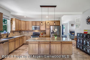 Gourmet kitchen with granite counters and stainless steel appliances.