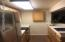 new fridge, ample counter space and much storage space