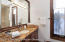 An efficient master bath with a beautiful stone shower.
