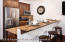 A refreshed kitchen with granite and stainless appliances create just the amount of space to enjoy dinner in on those snowy nights.