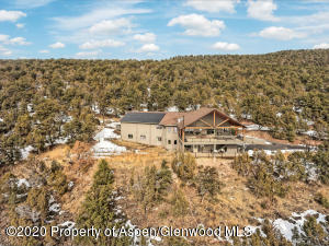 Aerial view of back of home with BLM land in background
