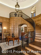 The grand central staircase leads up to the master suite