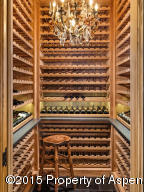 Generous wine storage is within the butler's pantry just off the kitchen