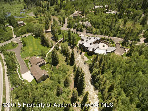 Aerial views show the expanse of the property and proximity to the river