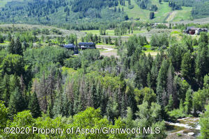 The Confluence of Maroon Creek and the Roaring Fork River wrap around Lot 12.